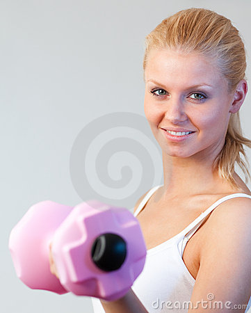 Close-up of a friendly woman trained with weights