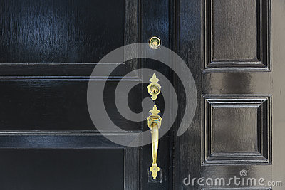 close up of front door with door handle and two locks stock photo close up of front door with door handle and two locks stock photo