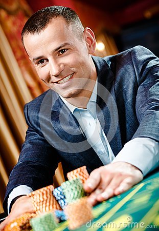 Close up of gambler stakes playing roulette