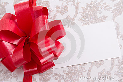 Close up of gift box with big bow and empty greeting card