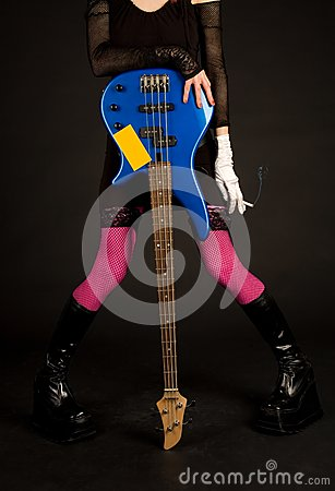 Close-up of girl with bass guitar and cigarette