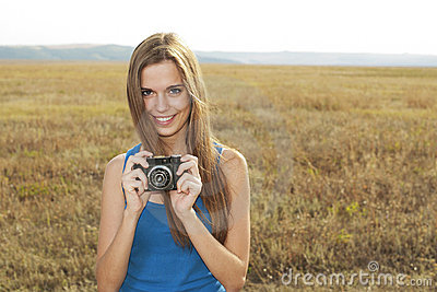 Close up of a girl clicking camera