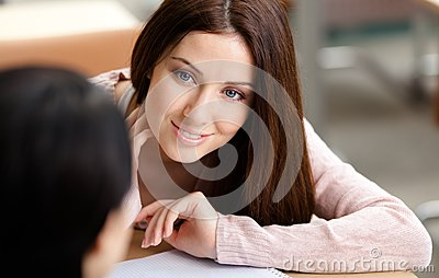 Close up of girl looking at another one