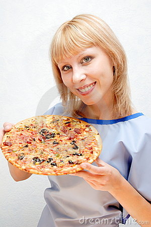 Close-up of a girl with the pizza.