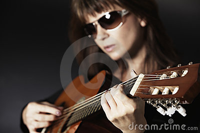Close Up Of Girl's Hand Playing Guitar. Royalty Free Stock Image - Image: 18237456