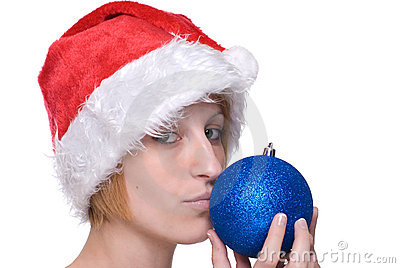 Close up girl in santa hat kiss decoration ball