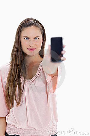 Close-up of a girl showing a smartphone