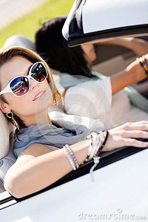 Close up of girls in sunglasses in the automobile