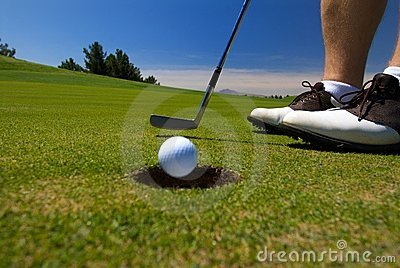 Close up of golfer teeing off