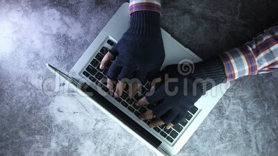 Close up of hacker hand stealing data from laptop. Selective focus. cyber crime concept. hacker hand stealing data stock video