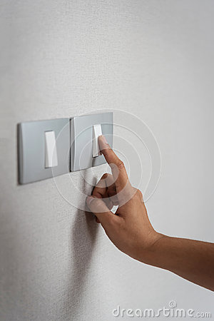 Free Close Up Hand Turning On Or Off On Grey Light Switches Stock Photo - 98061050