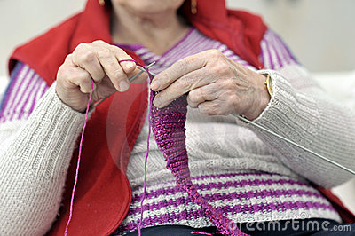 Close-up on hands of knitting senior woman
