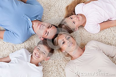 Close-up Of Happy Family Looking Up Together