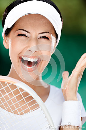 Close up of happy sporty woman with tennis racket