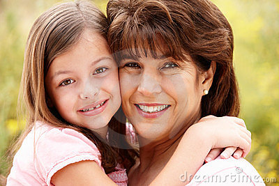 Close up of hispanic grandmother and granddaughter