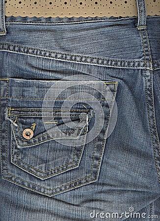 Close up of jeans back pocket.