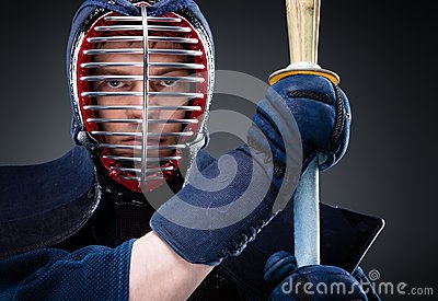 Close up of kendo fighter with shinai