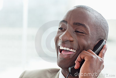 Close up of a laughing businessman on the phone