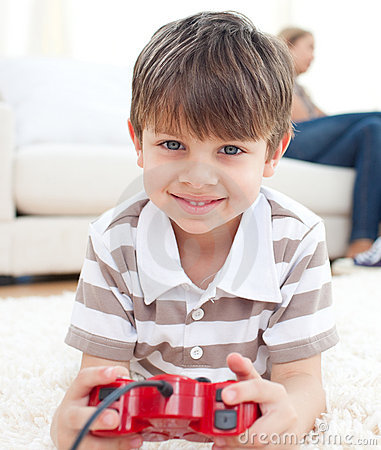 Close-up of little boy playing video games