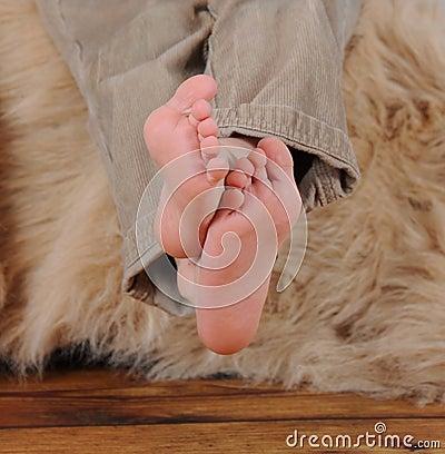 Close-up of little boys bare feet