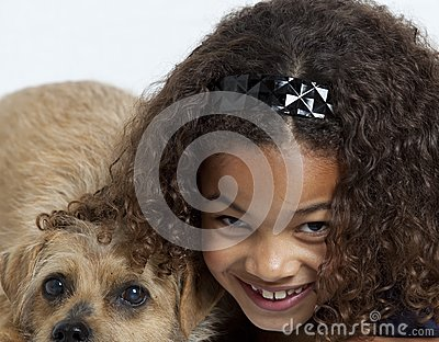Close up of little girl with dog