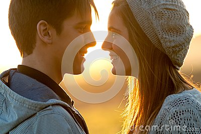 Close up of in love couple at sunset.