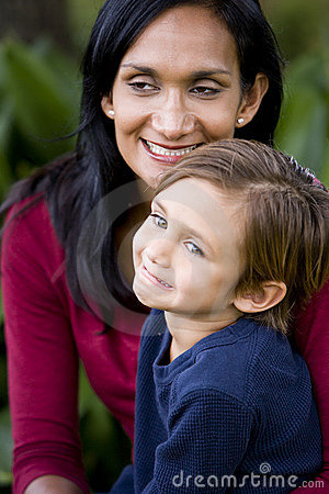 Close-up of loving mother with young son