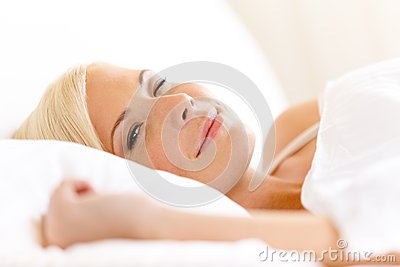 Close up of lying in bed woman