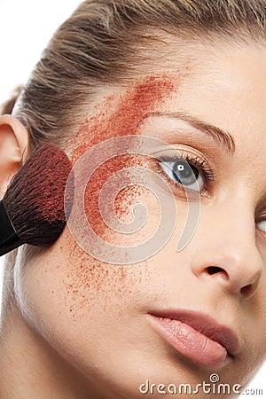 Close up of makeup powder on a cheek