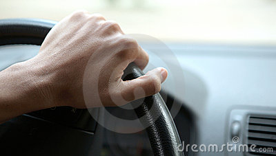 Close-up of a male hand on steering wheel