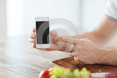 Close up of male hands holding smartphone