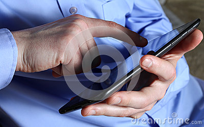 Male hands with tablet