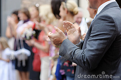 Close-up of man clapping his hands