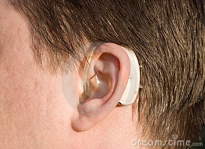 Close-up of a man ear with a hearing aid