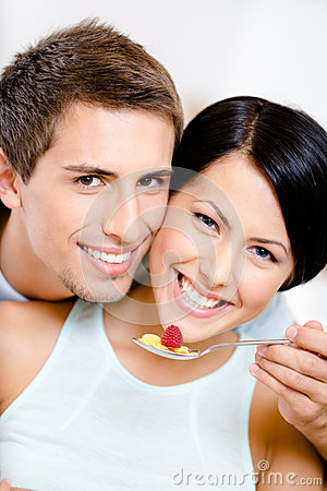 Close up of man feeding his girlfriend