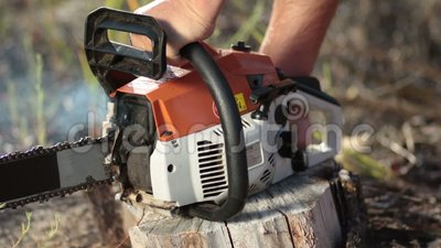 Close up man hands starting chainsaw stock video