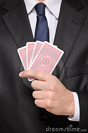 Close up of a man holding cards