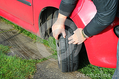 close up of a man inspecting car tires or tyres stock photo image 39617519. Black Bedroom Furniture Sets. Home Design Ideas
