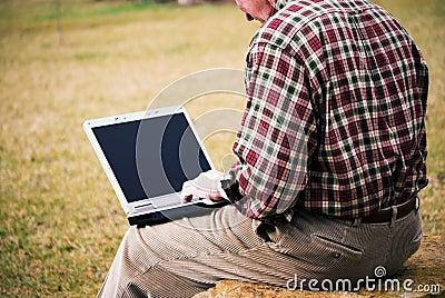 Close up man with laptop