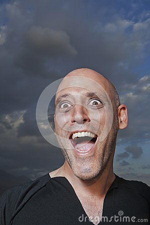 Close-up of a man looking excited outdoor