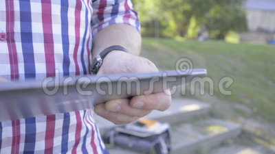 Close up on man`s hands browsing tablet. Slider shot. stock video