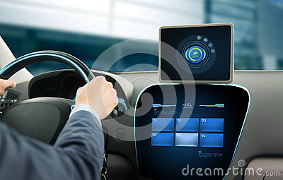 Close up of man with tablet pc driving car Stock Photo