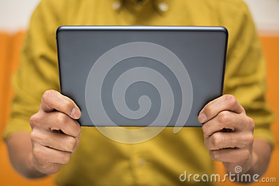 Close-up of a man using a digital tablet