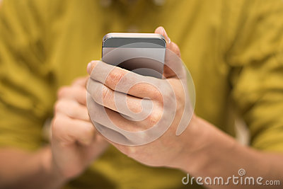 Close up of a man using a mobile smartphone