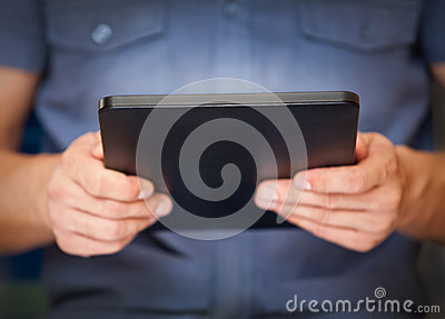 Close up of a man using tablet pc