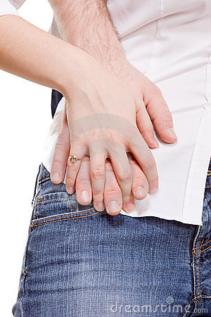 Close up on man and woman hands holding together