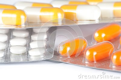 Close up of medicine pills and capsules packed in blisters