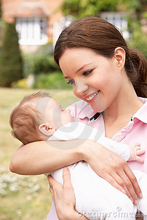 Close Up Of Mother Cuddling Newborn Baby Boy Outdo