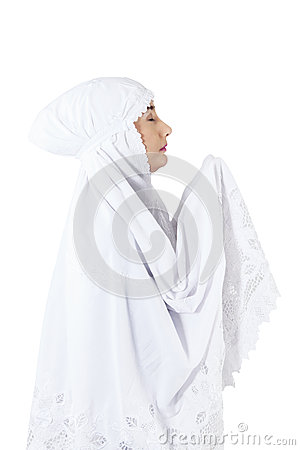 Close-up of muslim woman praying on white background