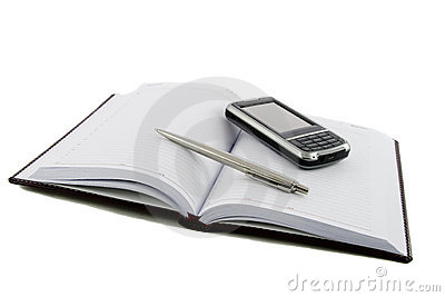 Close up notebook, pen and mobile phone